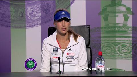 2013 Girls' champion Belinda Bencic talks to the media