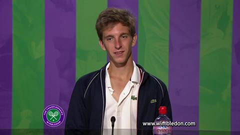 Wimbledon Boys' Singles champion Filip Peliwo talks to the media