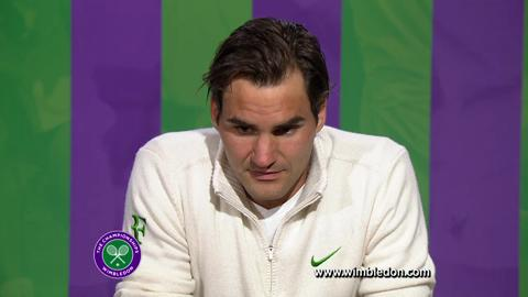 Wimbledon champion Roger Federer talks to the media