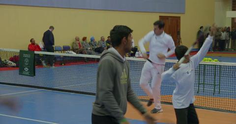 Tennis in a school sports hall