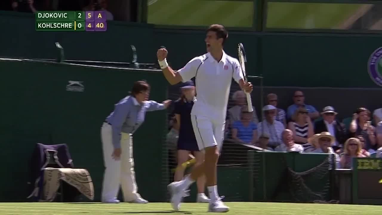 Novak Djokovic kisses the turf