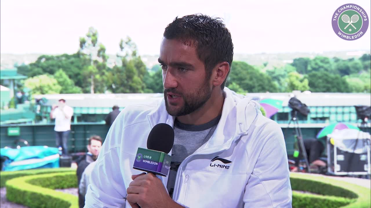 Marin Cilic escapes rain to ease into fourth round