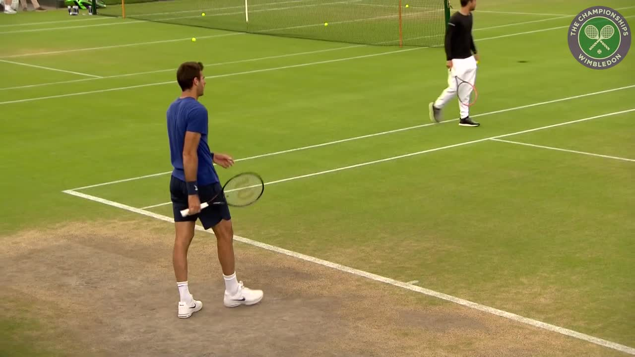 Juan Martin del Potro on practice court before resuming third round battle