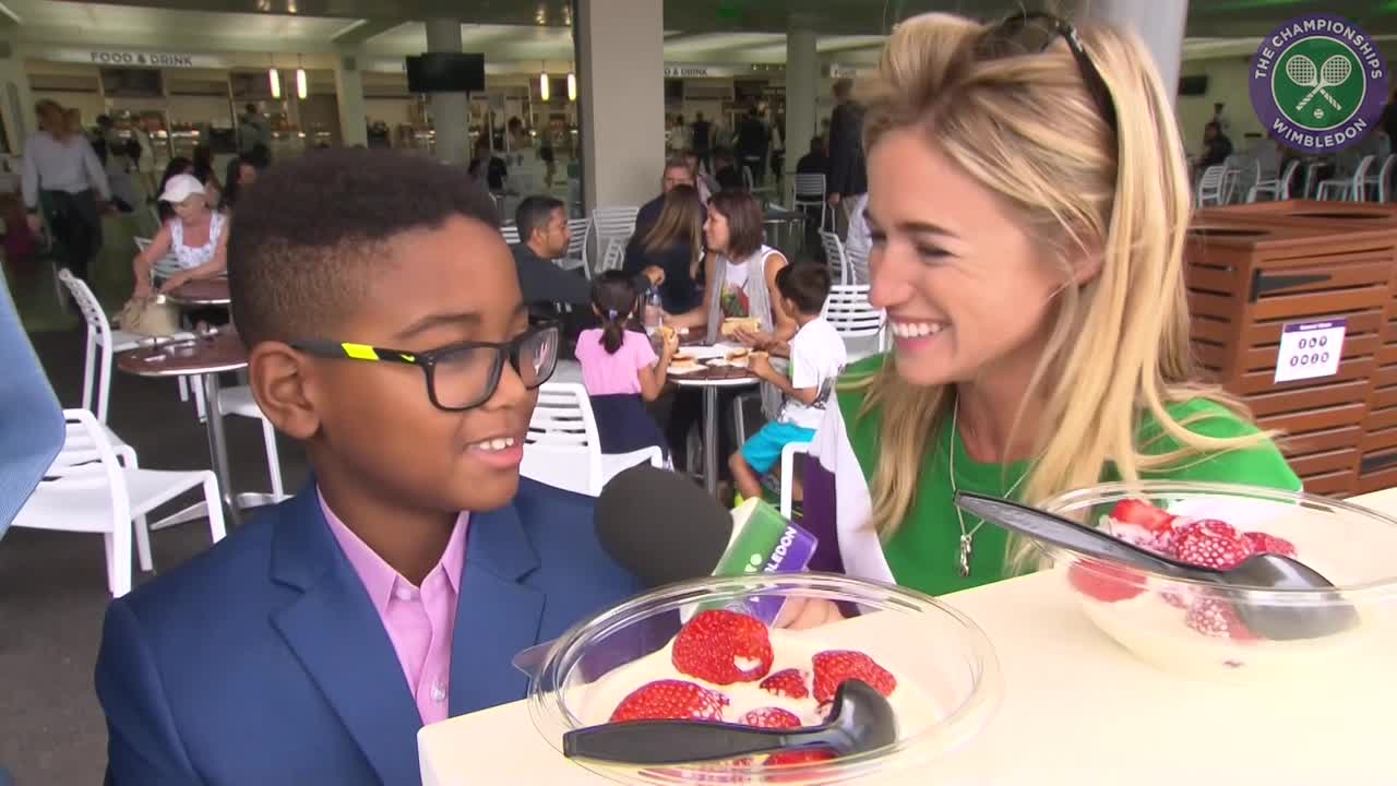 Osi Umenyiora enjoys the full Wimbledon experience with strawberries and cream