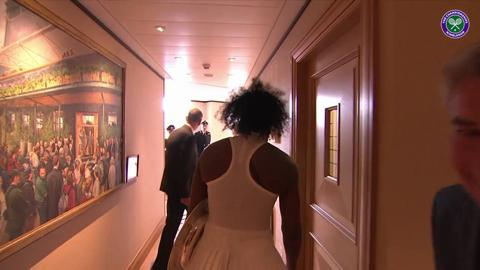 Serena shows off her new trophy to the fans